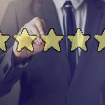 businessman draws five gold stars
